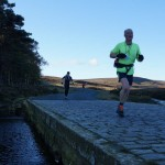 2012-saltergate-circuit-scarborough-and-ryedale-mountain-rescue-running-over-bridge