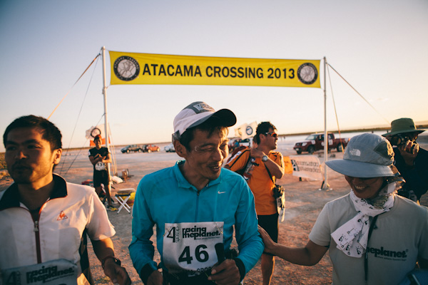 Keijiro Hamada - blind runner with guides, Atacama Crossing, Photo: Shayne Boyte, Image courtesy Racing the Planet