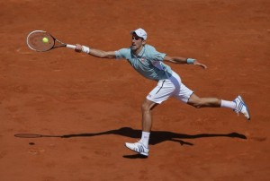 Novak Djokovic reaches across the court in the French Open, June 2013.