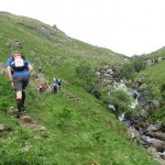 Competitors run up Wyth Burn during the 10 Peaks, Lake District, UK, 2013