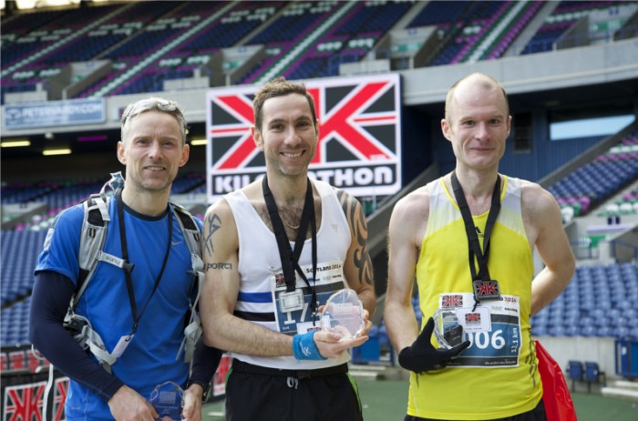 Kilomathon 13.1K Winners: Bryan Mackie (middle) with second place Robert Turner (left) and third place finisher Chris Poxton (right). Photo by Mark Beautyman.