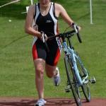 oldbury-white-horse-triathlon-2014-woman-cyclist-transition-chip-timing