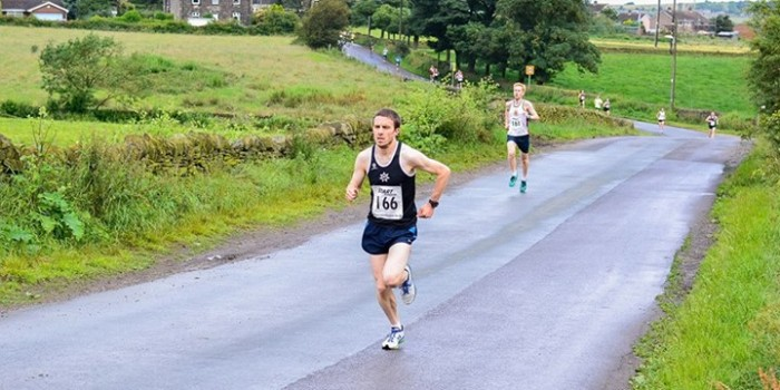 Penistone 10K Road Race - Aidan Johnson of Rotherham Harriers leads after 2 kilometres, followed by Andy Swift of Penistone Footpath Runenrs & AC at Castle Dam.